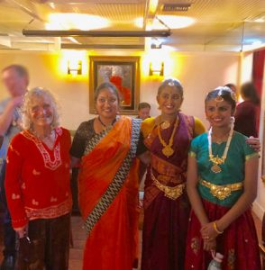 Barbara L. Baer with traditional Indian dancers